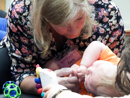 ABM Practitioner works with baby